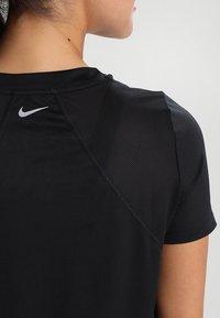 Nike Performance - DRY MILER - Basic T-shirt - black/reflective silver - 5