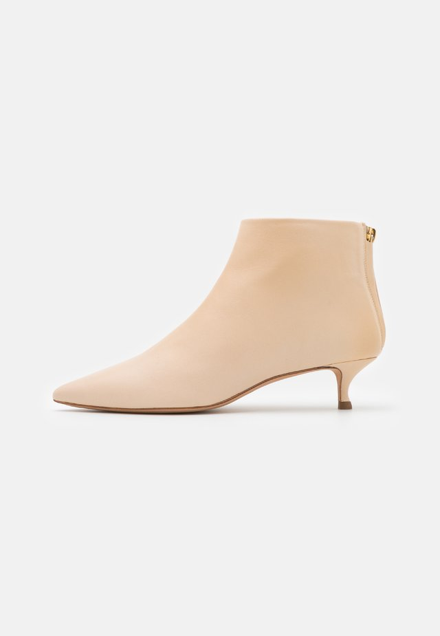 Ankle boots - cream