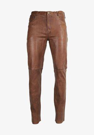 TRANT  - Leather trousers - cognac braun