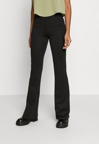 ONLY - ONLFEVER FLAIRED PANTS - Trousers - black - 0