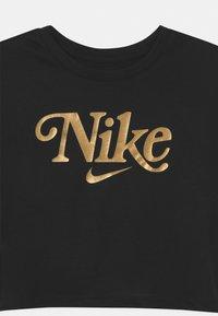 Nike Sportswear - STUDIO FUTURA - T-shirt z nadrukiem - black - 2