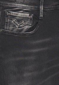Replay - ANBASS HYPERFLEX BIO - Slim fit jeans - black - 7