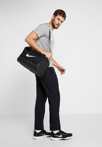 Nike Performance - Sports bag - black/white - 1