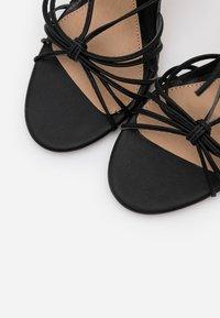 Missguided - KNOTTED STRAPPY STILETTO - Sandaler med høye hæler - black - 5