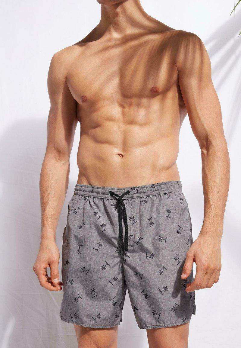 Calzedonia - Swimming shorts - palme melange