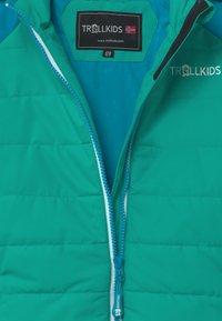 TrollKids - HAFJELL SNOW PRO UNISEX - Lyžařská bunda - light petrol / dark mint / white - 2