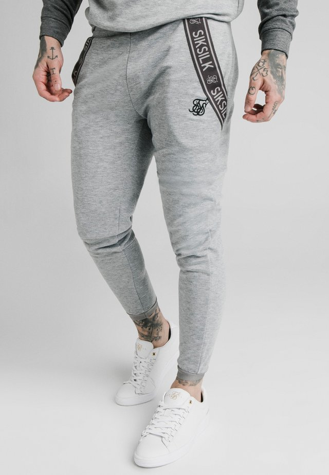 TECH TRACK PANTS - Pantalones deportivos - grey