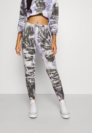 ÇOK RENKLI - Pantalon de survêtement - lilac/black