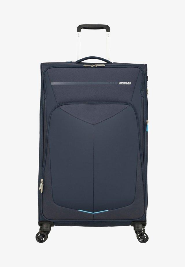MIT 4 ROLLEN - Wheeled suitcase - navy