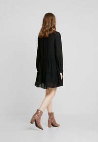 Vero Moda - VMCAITLIN SHORT DRESS - Day dress - black - 2