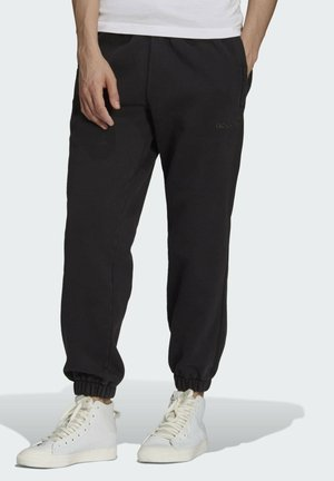 DYED HOSE - Tracksuit bottoms - black