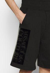 Versace Jeans Couture - LOGO - Pantalon de survêtement - black - 5