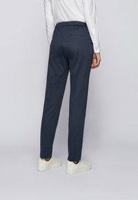 BOSS - TAHWENA - Trousers - patterned - 2