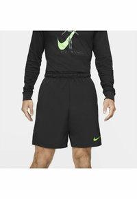 Nike Performance - FLEX SHORT - Träningsshorts - black mean green - 4