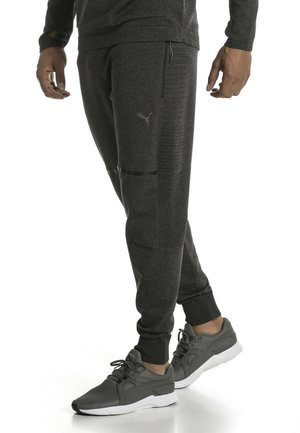 EVOKNIT  - Tracksuit bottoms - black heather