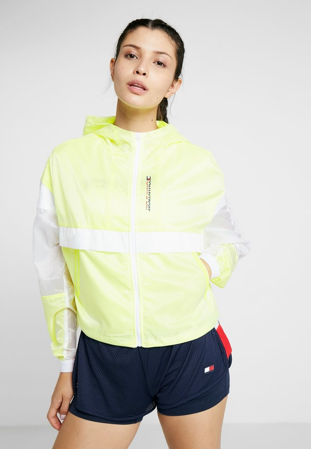 WITH TAPE - Veste coupe-vent - yellow
