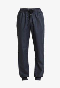 UNISEX TROUSERS - Teplákové kalhoty - blue