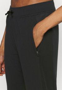 Nike Performance - WARM PANT RUNWAY - Tracksuit bottoms - black/reflective silver - 5