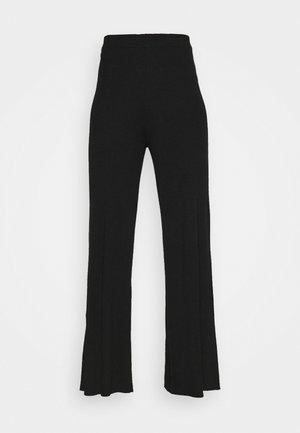FLARED PANTS - Tygbyxor - black