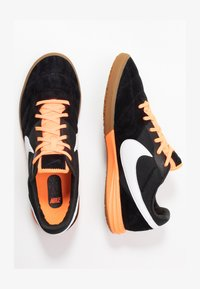 black/white/total orange