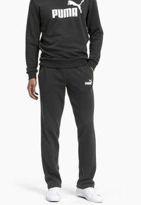Puma - ESSENTIALS - Pantalon de survêtement - black - 0