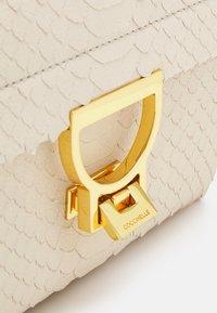 Coccinelle - ARLETTIS PYTHON LULULA - Handbag - white - 4