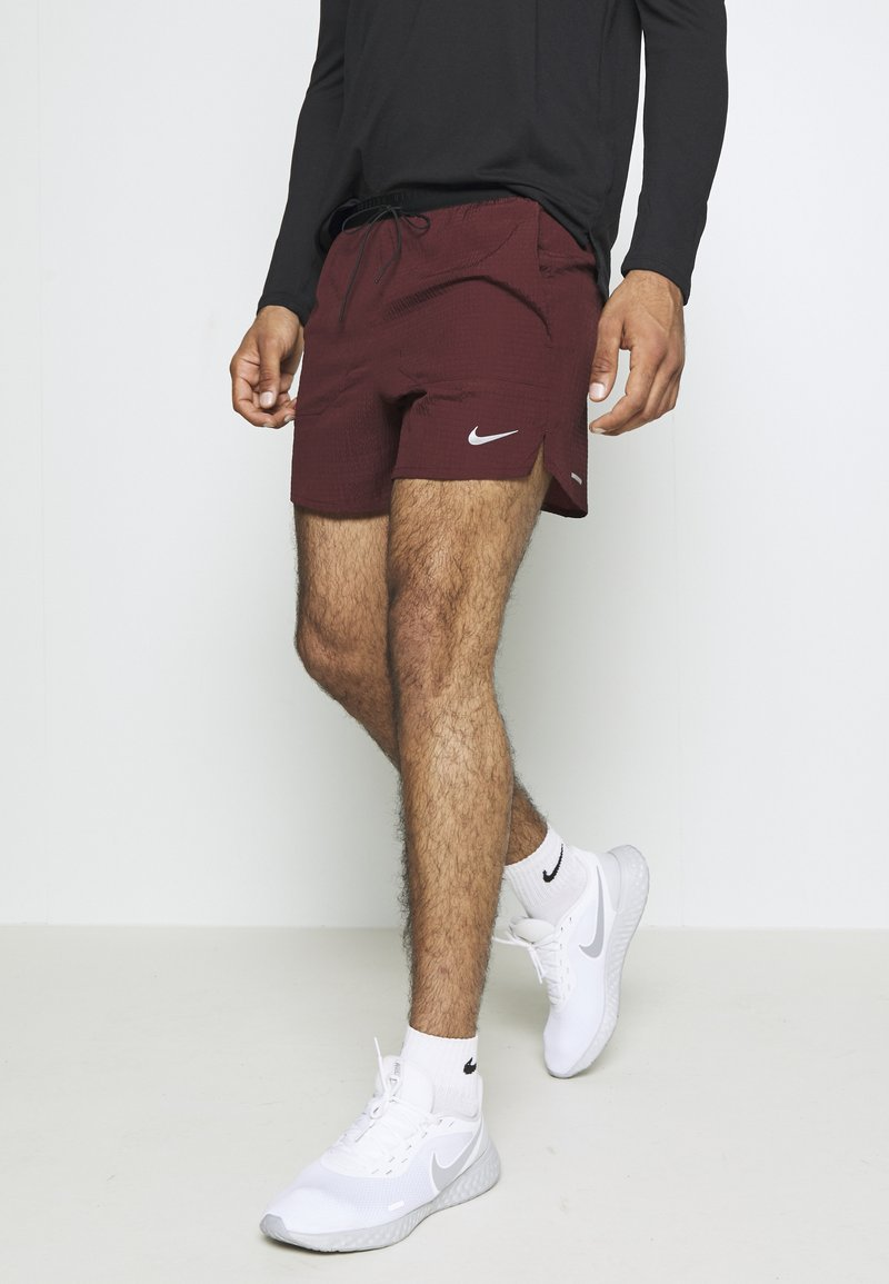 Nike Performance - RUN DIVISION FLEX STRIDE - Sports shorts - mystic dates/black/silver