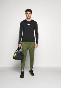 adidas Performance - TECH PANT - Tracksuit bottoms - wild pine - 1