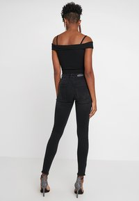 ONLY - ONLBLUSH RAW - Jeans Skinny Fit - black denim