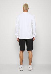 Night Addict - Shorts - black - 2