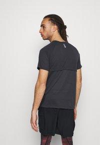 Under Armour - STREAKER - T-shirt basic - black - 2
