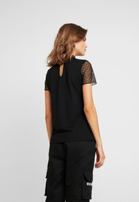 ONLY - ONLCATHY - Print T-shirt - black - 2
