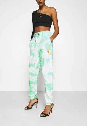 PLAYBOY TIE DYE - Tracksuit bottoms - mint