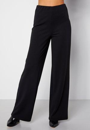 PETRONELLA - Trousers - black