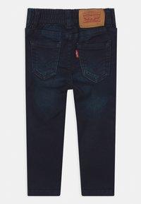 Levi's® - SKINNY PULL ON UNISEX - Slim fit jeans - dark-blue denim - 1