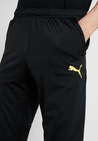 Puma - BVB BORUSSIA DORTMUND TRAINING PANTS WITH ZIP POCKETS - Tracksuit bottoms - black/cyber yellow - 3