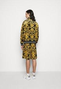 Versace Jeans Couture - TECNO PRINT LOGO BAROQU - Sweater met rits - black - 2
