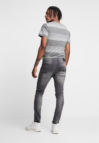 G-Star - REVEND SKINNY - Jeans Skinny Fit - slander grey superstech - 2