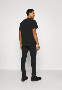 Nudie Jeans - LEAN DEAN - Džíny Slim Fit - black skies - 2