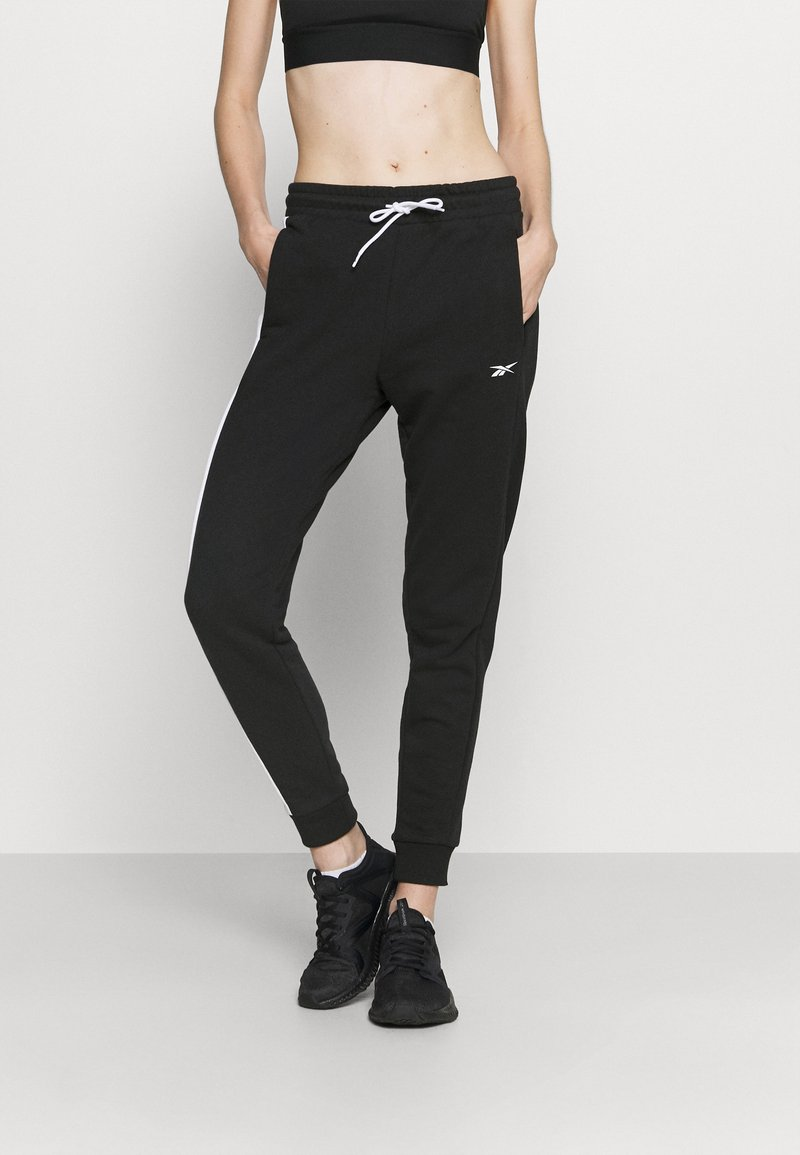 Reebok - LINEAR LOGO PANT - Teplákové kalhoty - black