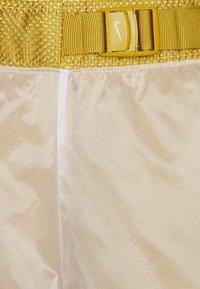 Nike Sportswear - PANT - Tracksuit bottoms - dark citron/white/black - 6