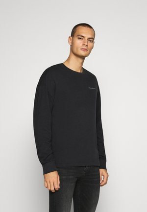 EXPLODED - Long sleeved top - black