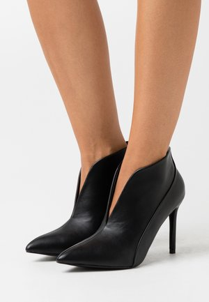 PATCH - High heeled ankle boots - black