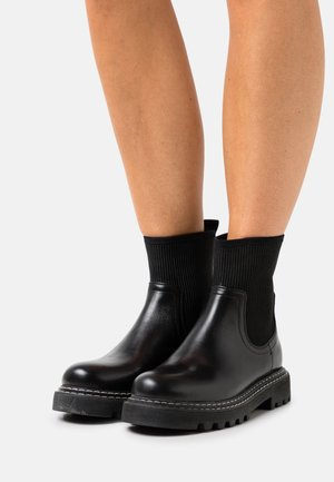 NEW LINA - Classic ankle boots - black