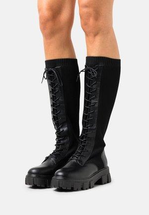 VEGAN TINSLEYY - Lace-up boots - black