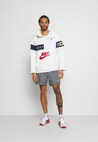 Nike Sportswear - FLOW GRID - Shorts - black/white - 1