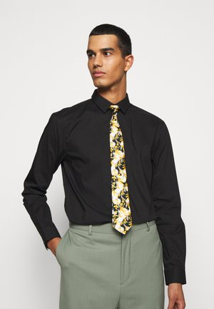 Tie - bianco/nero/oro