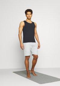 Curare Yogawear - SHORTS - Sports shorts - lightgrey melange - 1