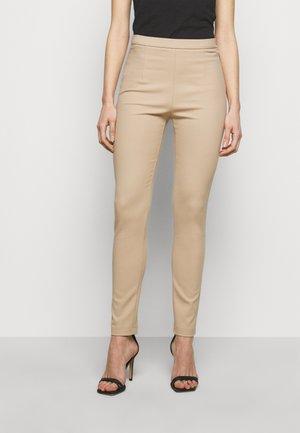 PANTALONI TROUSERS - Trousers - triking beige