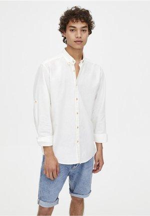 MIT LANGEN ÄRMELN  - Shirt - white